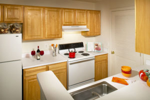 Kitchen with oven, sink and cabinets